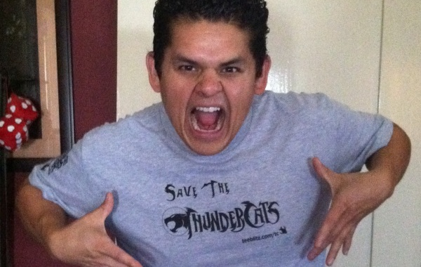 Aris Alvarado in a Save The Thundercats T-shirt