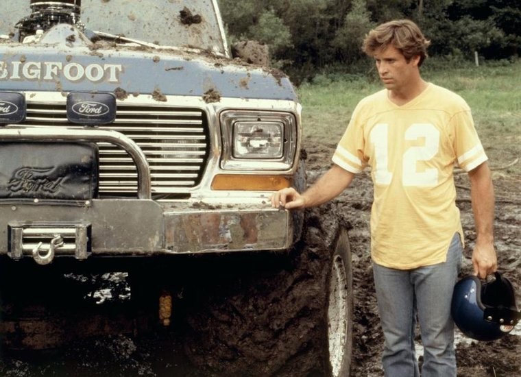 """A still of the legendary Bigfoot Monster Truck and actor Robert Hayes from the movie """"Take This Job And Shove It."""""""