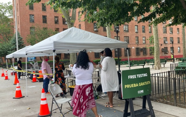 People register to get tested for COVID-19 at a Mobile Test Site operated by CORE in The Lower East Side.